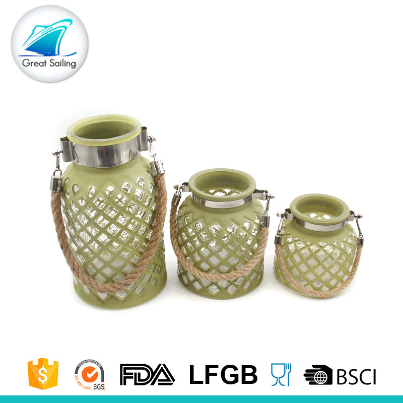 Green glass candle holder with handle