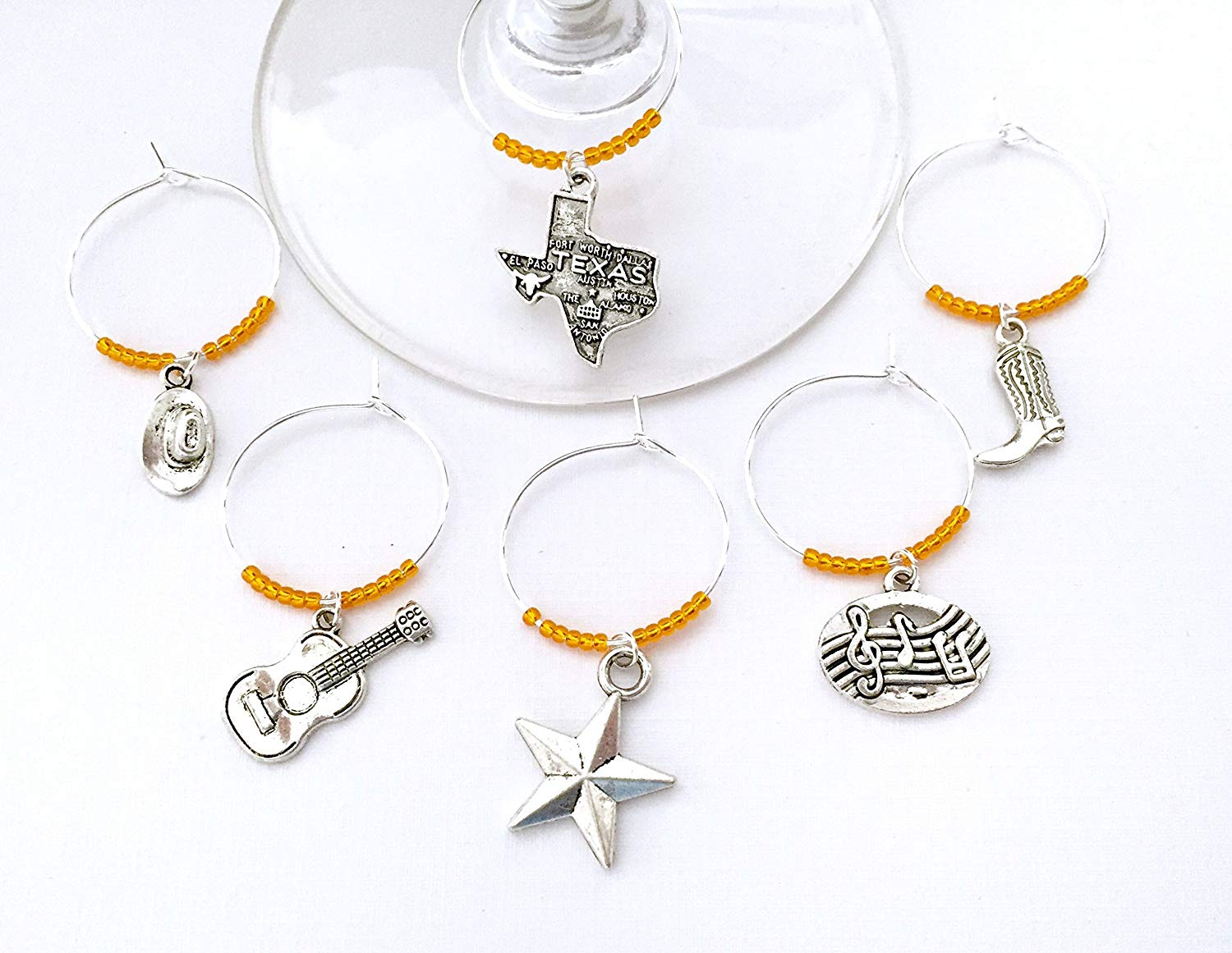 Austin Texas Wine Charms. Inspired by Austin Music and Country scene. Charms include Texas Charm, Guitar, Cowboy Hat, Cowboy Boots, Music Notes, and Texas Star. Set of 6.