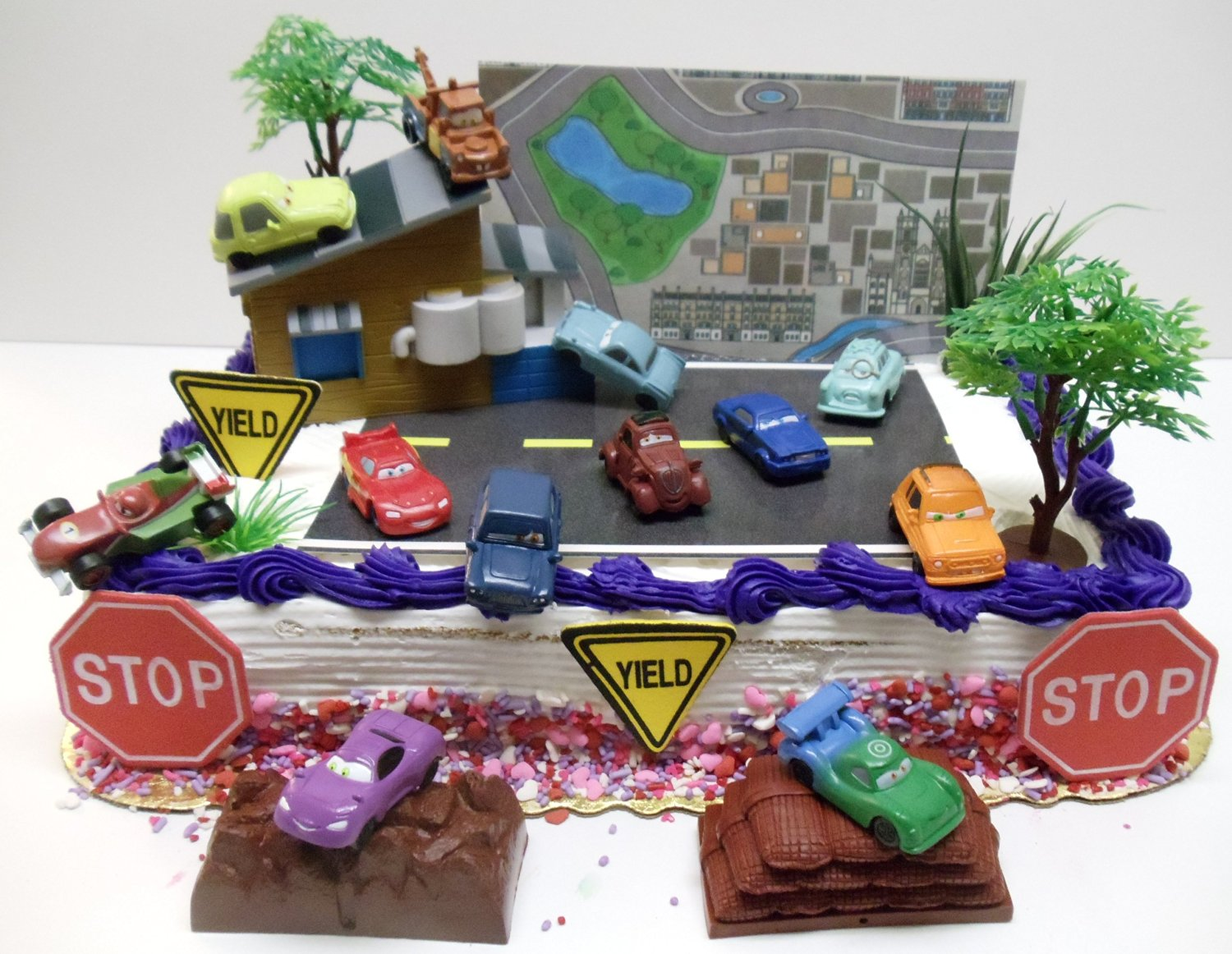 "Cars 2 Birthday Cake Topper Set Featuring 1.5"" Cake Toppers of Lightning McQueen, Tow Mater, Lemons, Finn McMissile, Francesco Bernoulli, Holley Shiftwell, Rod Redline, Uncle Topolino, Professor Z and Other Decorative Themed Pieces - Cake Topper Set Includes All Items Shown"