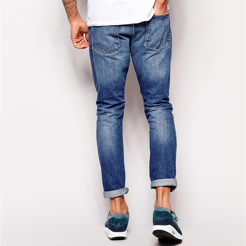Jeans by new look. A wardrobe staple. Dark-blue wash. Regular rise. Zip fly. Functional pockets. Slim fit. A narrow cut that sits close to the body.