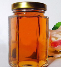 Best selling six rowed glass canned jar hexagon honey with metal lid