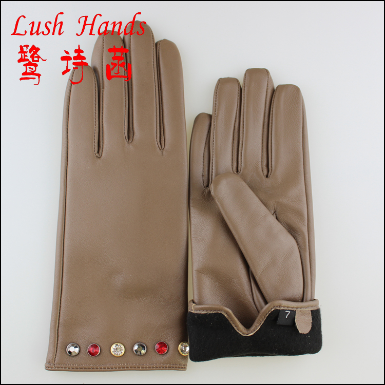 With diamonds decorated women fashion leather gloves