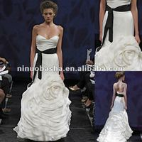 Sweetheart neckline with a camellia flower wrapping the skirt wedding dress