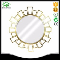 Wholesale ce rohs golden round leave art metal wall mirror