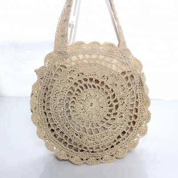 hot selling travel seaside holiday folding woven hollow out straw beach bag round handmade ladies handbag