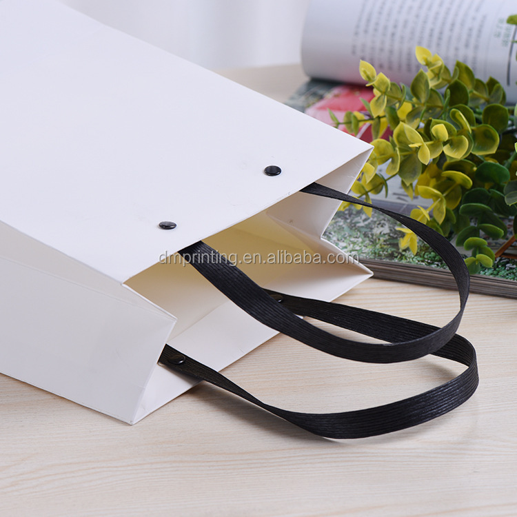 Yiwu fancy small blank paper bag with rivet handle gift
