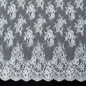 Factory price 100% Nylon white elegant thick voile floral eyelash lace fabric for wedding dress