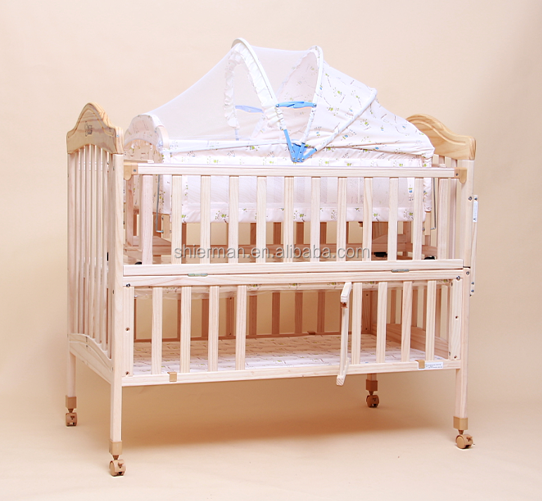 Multipurpose wooden baby crib with wheels buy baby crib for Baby bed with wheels