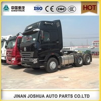 china heavy duty truck/ SINOTRUK HOWO 6x2 4X2 4x4 cheap tractors /table of prices of new tractors