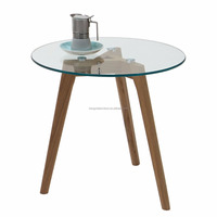 scandinavian small round glass coffee table set with solid oak legs