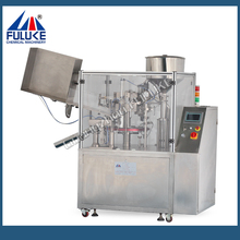 FLK ointment filling machine with bottle unscrambler