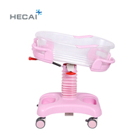 Hospital baby crib with hi-low adjustment