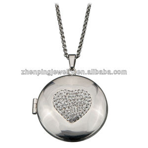 2013 Women's Polished Round Locket Pendant w/ Round Design CZ's at the Center.Stainless Steel locket pendant