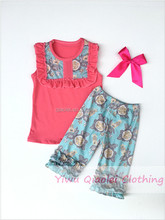 Red Color tunic top blue floral bib & double ruffle icing capris