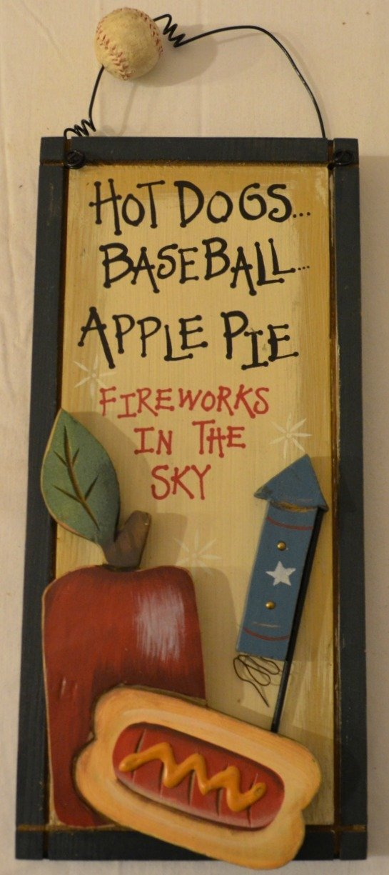 """Rustic Country Wood Plaque Sign Decoration with a Metal Wire for Hanging 5 1/2 x 12 x 3/4 Inches. Wooden Sign Saying """"Hot Dogs... Baseball... Apple Pie Fireworks In The Sky"""" with Decoration Fireworks, Apple, Hot Dog, and Dark Blue Border"""