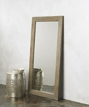 Unfinished Wooden Mirror Frame Leaning Against the Wall
