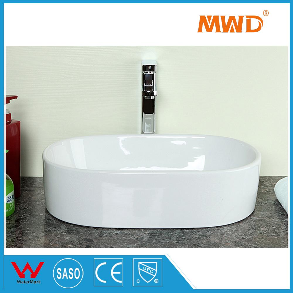 samll montaje sobre encimera lavabo del bao fregadero de la cocina de porcelana