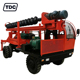 Wheeled ground screw portable pile driver machine