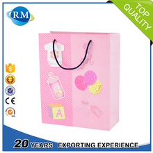Customized vogue kraft paper shopping bag wholesale