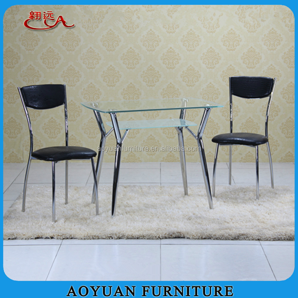 C267 tempered glass and chromed legs dining table designs four chairs