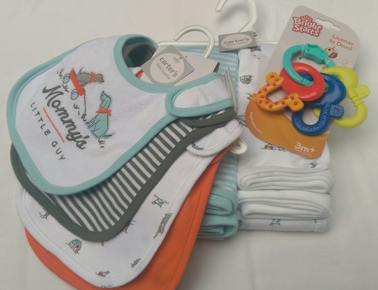 Baby Gift Bundle - 3 Items: Carter's Baby Boy Little Layette Blankets 2-pack, Carter's Baby Bibs 4-pack, and Bight Starts Baby Teething Keys.