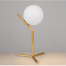 Brushed brass finish metal frame home goods glass table lamp