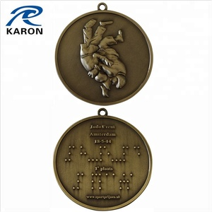 antique plated 3d holland taekwondo medal with braille