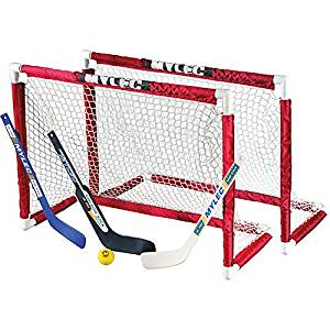 Hockey Deluxe Mini Goal Set Includes: Two (2) Mini Goals, Two (2) Pre-curved Mini Sticks (1 Left and 1 Right), One (1) Pre-curved Lefty Goalie Stick and One (1) Foam Hockey Ball