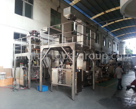 Automatic pouch corn packaging system