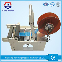 Round bottle applicator labeling cutting machine for sale