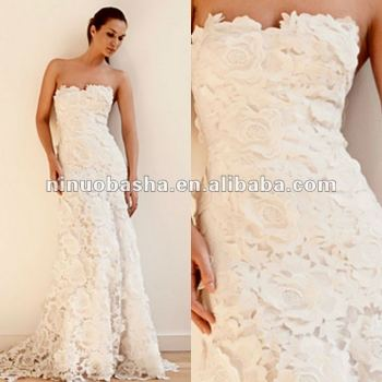 A floor length guipure Venice lace wedding dress
