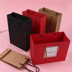 China Manufacturer Wholesale cheap Paper Shopping Bags Recycled luxury Clothes Packaging kraft paper Bag