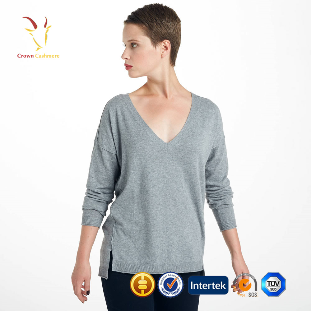 Sweet and sporty, this comfy sweater features a feminine silhouette with a curvaceous hem, a playful pairing of diamond and rib stitching, and an asymmetrical collar to wear snapped up or draped open.