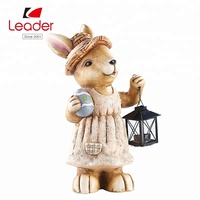 Hot selling Polyresin Bunny with candle lantern easter art statue for home and outdoor ornament