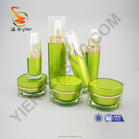new eyes shape with green color acrylic plastic container and bottle for beauty and cosmetic