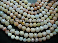 14 Inches Pink Peruvian Opal Gemstone Faceted Round Beads Size 5MM Approx Wholesale