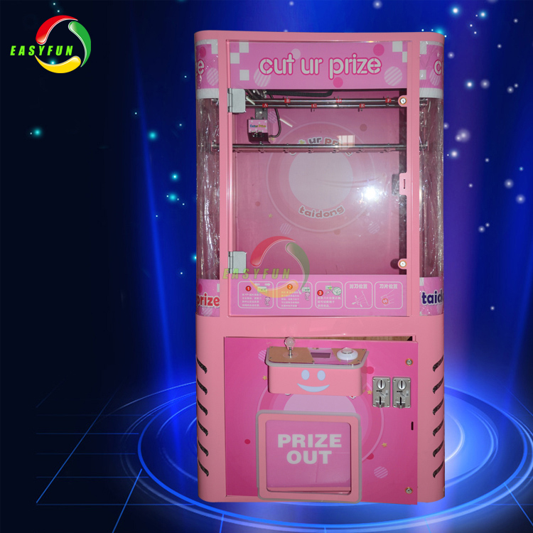 Coin operated toy crane claw game cut ur prize vending machine
