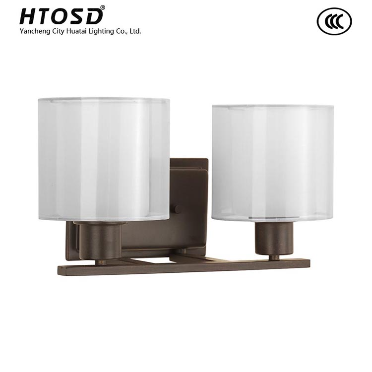 Htbv0025 Two Light Bath Fixture With Inner Gl Globe Encircled By A Translucent Sheer Mylar Shade