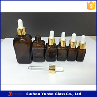 Wholesale Square Essential Oil Glass Dropper Bottle 15ml 30ml with Gold Glass Dropper
