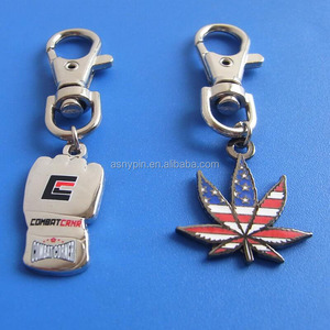 metal boxing gloves and maple leaf shaped US flag key fob