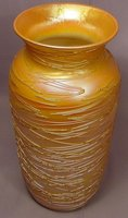 Beautiful tall gold iridescent threaded art glass vase signed V.