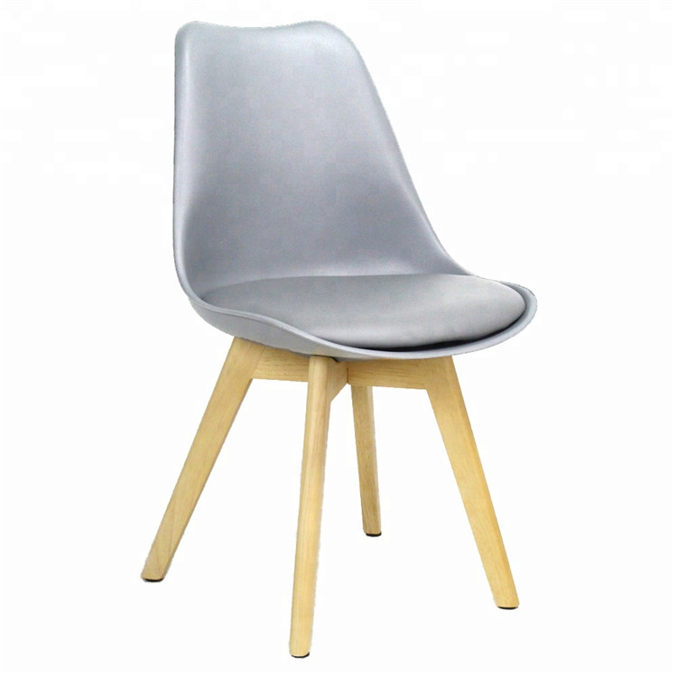 Modern design plastic chair wood leg plastic dining chair for dining room
