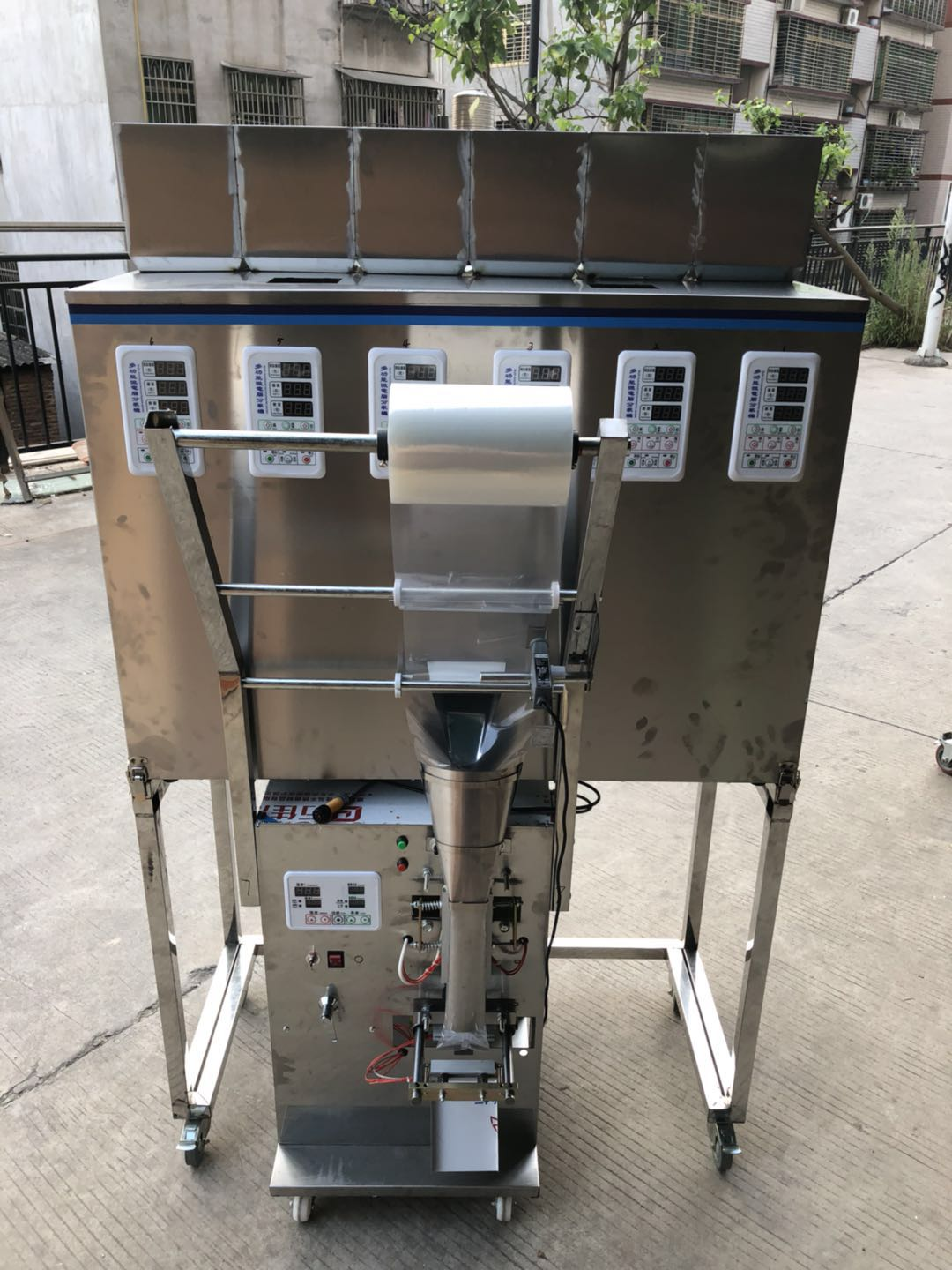 Factory price automatic four weighing mixing seeds granules packing machine for sale