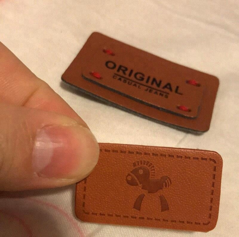 Wholesale custom cheap leather label with high quality for garments