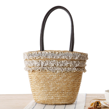The new lace straw bag woven bag summer fashion hand carry bag