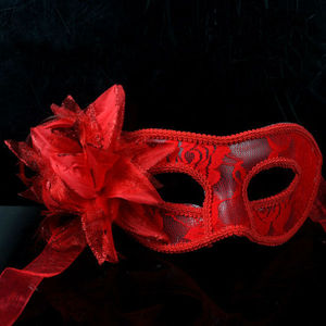 clear mask covered with red lace and flower