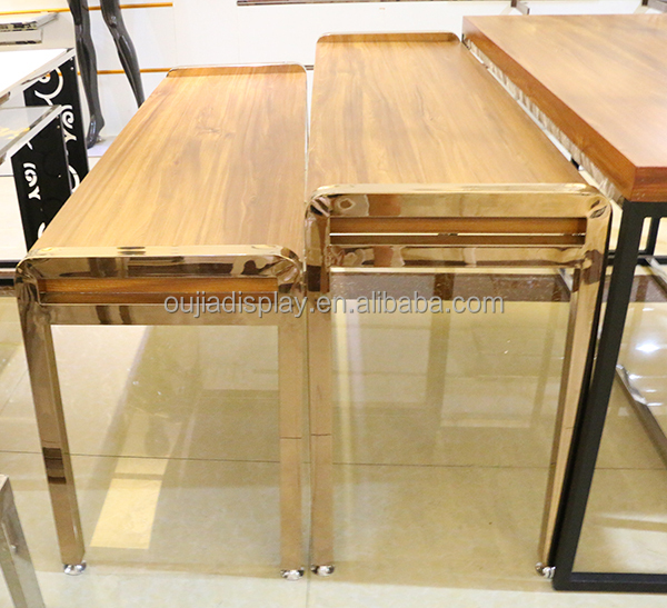 furniture high end. luxury nesting tables in fashion clothing shop display high end furniture brands