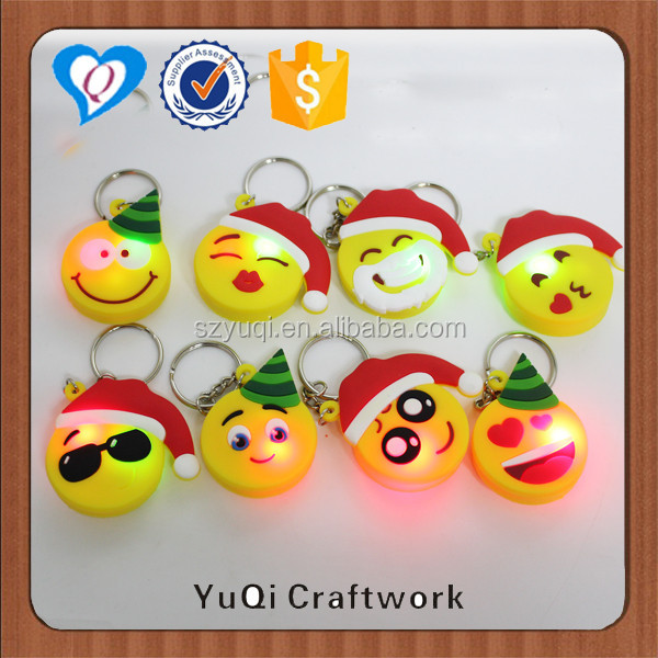 Light-up smiley face led keychain