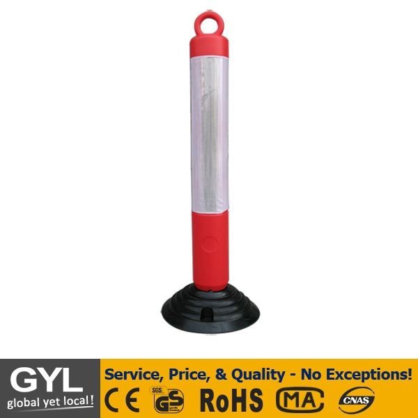 red and white plastic fence sign post