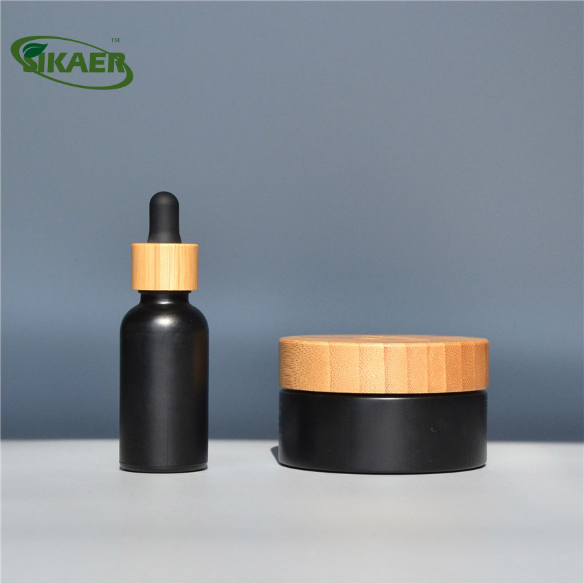 Customized made 30ml bamboo black glass oil facial essence dropper bottle and cream jar set cosmetic packaging